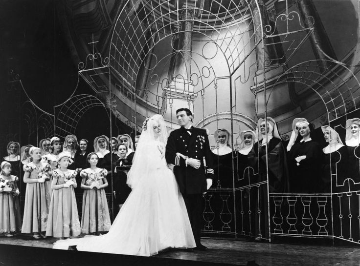 The Sound of Music opened on Broadway on November 16, 1959, featuring the classic wedding scene that so many of us remember from the 1965 film version. Pictured here are stage actors Mary Martin and Theodore Bikel, surrounded by the nuns of Nonnberg Abbey and the von Trapp children.