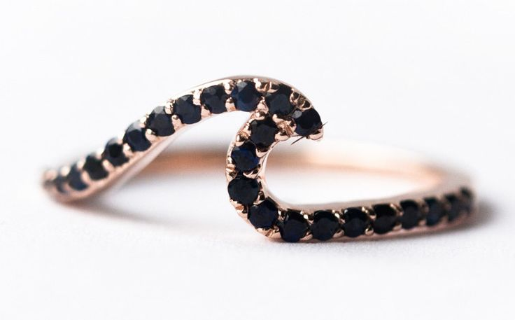 "A <a href=""https://go.redirectingat.com?id=74679X1524629&sref=https%3A%2F%2Fwww.buzzfeed.com%2Fsarahhan%2Fgorgeous-sapphire-engagement-rings&url=https%3A%2F%2Fwww.shopspring.com%2Fproducts%2F52732805%3Fquery%3Dsapphire%2Bring&xcust=4494153%7CBFLITE&xs=1"" target=""_blank"">black sapphire wave ring</a> that may or may not cause a ripple in time."