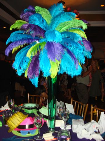 Purple and turquoise Wedding Centerpieces | ... trend in party rentals ostrich feather centerpieces have become very