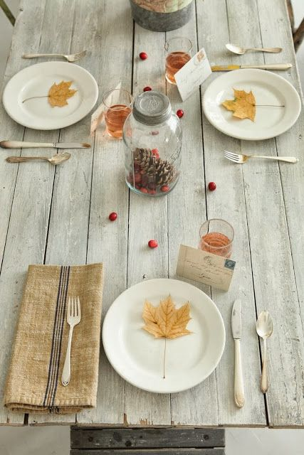 keep the table setting simple so you're not stressing about it -- cutlery, plates and decorate with a golden leaf on each plate.