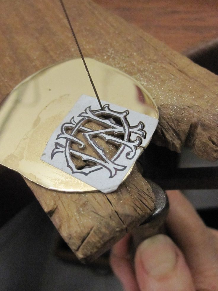 Using a very fine jewellers saw blade allows me to get into all the small spaces. Half way through a 9 carat yellow gold monogram order.  For information on monograms and other pieces I make please go to  http://www.etsy.com/shop/PearlsByDesign