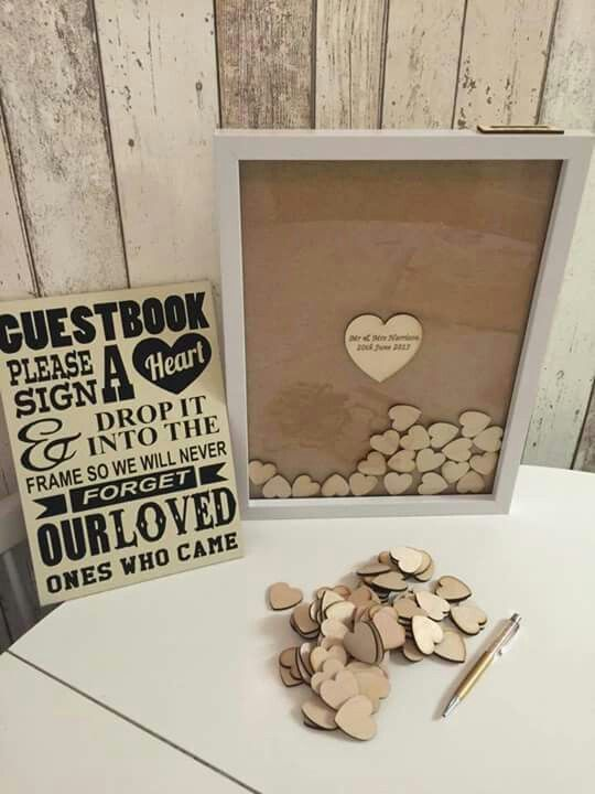 Our Guestbook idea. We have frame, wood hearts and sign Mehr