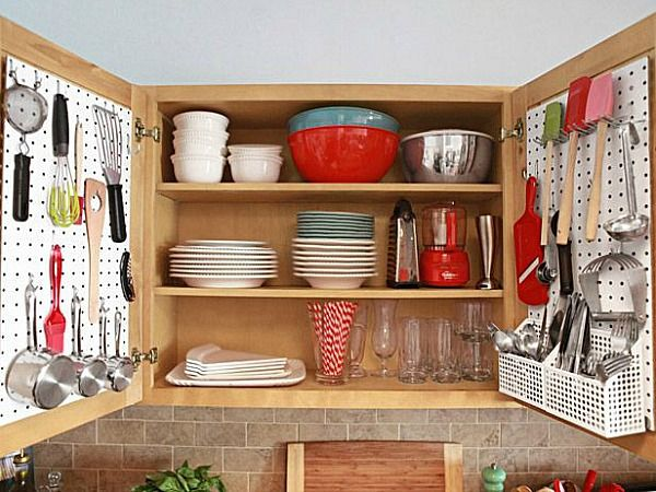 How to make your small kitchen work bigger! Working in a small kitchen can be challenge. Here are some great ideas for making the most of the space you have like this one - using your whole cupboard space efficiently.