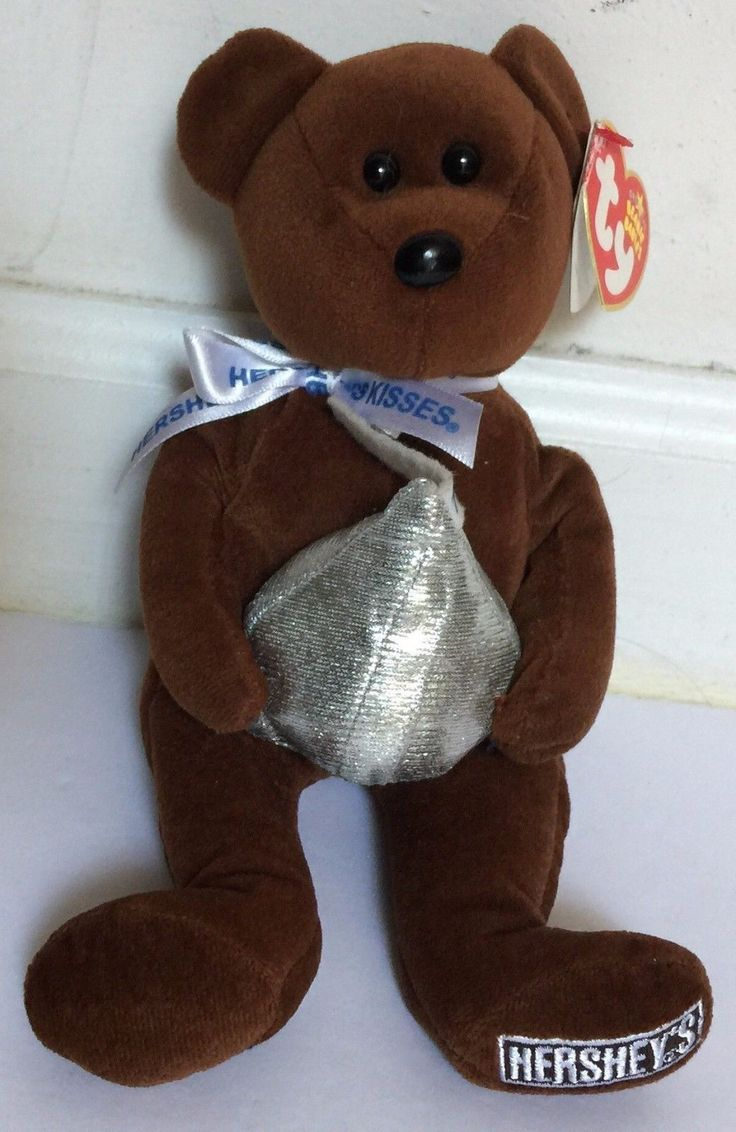Ty Hershey Kisses 100 Years Brown Original Beanie Baby Cocoa Bean w/Heart Tag  Gently pre-owned with intact heart tag, but has some minor creasing along the edge as shown. Otherwise, beanie baby is in excellent condition.