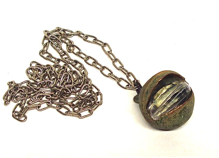 Upcycled bell pendant with quartz crystal by Linda Jones