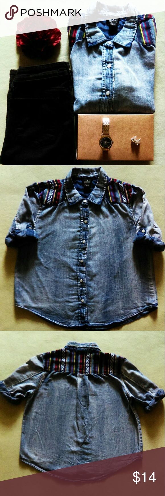 Women's denim tribal shirt Women's denim tribal shirt in a size medium but this can also fit a size small. In excellent condition. It has a gorgeous multicolored tribal pattern along with faux mother of pearl buttons on the front as well as on the sleeves. It has an intentional distressed look to the denim. The sleeves can either be worn long or rolled up to a 3/4 inch sleeve. Rue21 Tops Button Down Shirts
