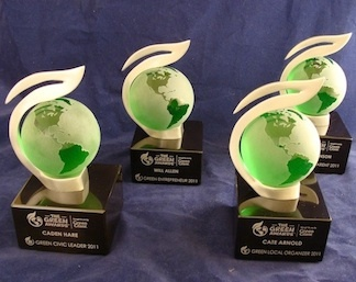 """Custom awards created for """"The Green Awards"""", an environmental program sponsored by Green Giant.     This unique custom trophy design is based on a 3D representation of The Green Awards logo. These distinctive trophies feature a pewter leaf-shaped design that holds a green crystal globe. The pewter leaf image is finished in brushed pewter. The green globes feature clear surfaces for each of the continents, and opaque surfaces for the oceans."""