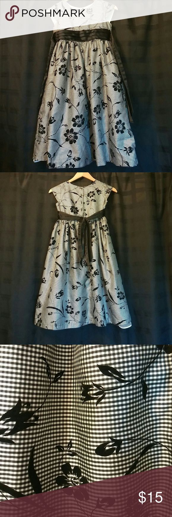 Girl's Fancy Dress by George Darling dress for those special holiday occasions, or school events. The black floral design is velvet, which gives the dress a very dark rich look. My daughter has outgrown it and cried, when I pulled it from her closet. The built in slip and tully gives the girl the feel of a princess in an evening gown. George Dresses