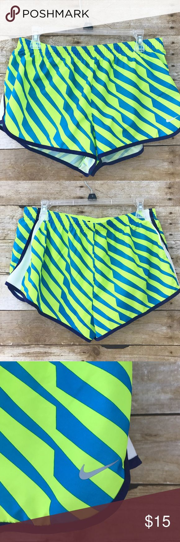 Nike Dri Fit Running Graphic Neon Shorts excellent condition neon graphic running Dri fit shirts by Nike. Only used once! 100% polyester.   **For your privacy, I do not tag buyers after purchase. I ship same day or next day (if you purchase after 1pm). However, if you have a question and don't mind being tagged, go ahead and ask under the item! Thanks! Nike Shorts