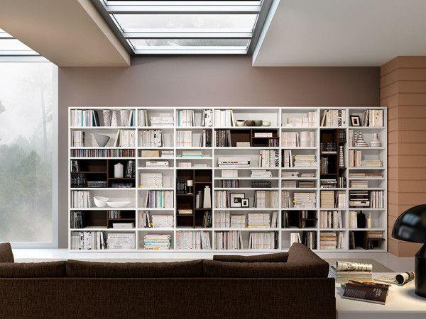 Libreria 77 - Ferrimobili: una forma alle emozioni. Ambienti ricchi di fascino, eleganza e modernità danno vita alle tue idee e ai tuoi sogni. Semplici ed efficaci elementi divisori scandiscono la divisione interna degli spazi a giorno.