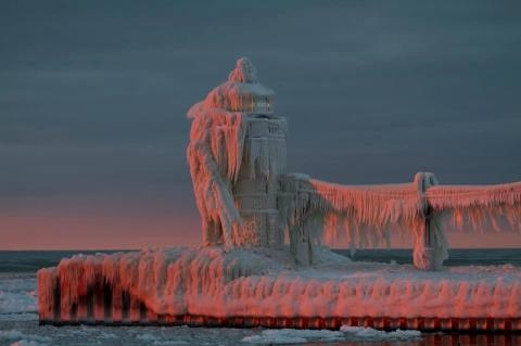 Ice covered St. Joseph, Michigan lighthouse at sunset. Photo by Lisa Davidson Rundell