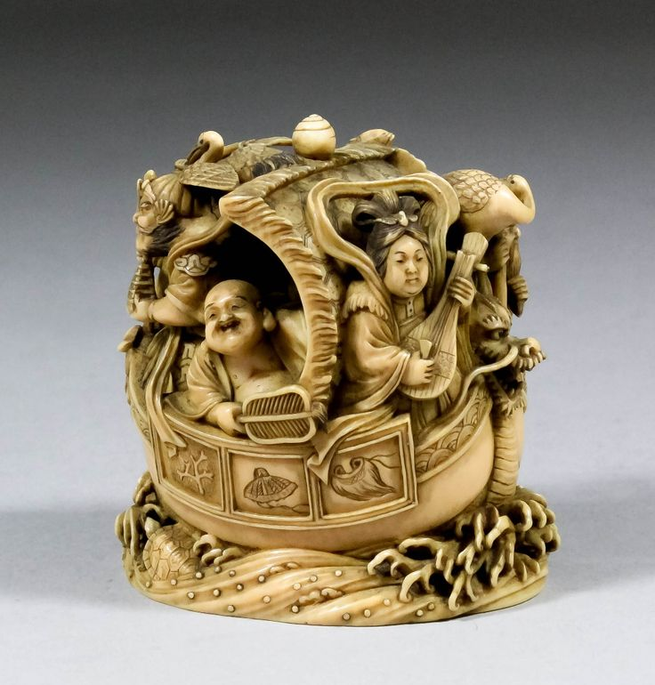 A Good Japanese Carved Ivory Okimono With Seven Figures