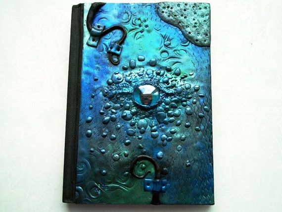 Hey, I found this really awesome Etsy listing at https://www.etsy.com/listing/209078740/polymer-clay-journal-teal-dragon-journal