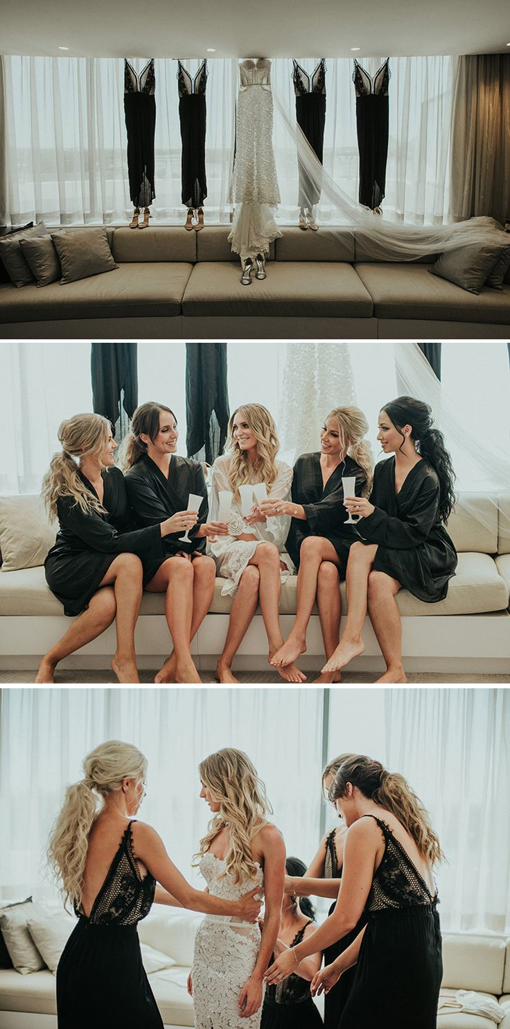 Modern bridal party styling with bridesmaids in black robes and dresses | Shannon Stent Images | See more: http://theweddingplaybook.com/modern-black-and-white-urban-wedding/
