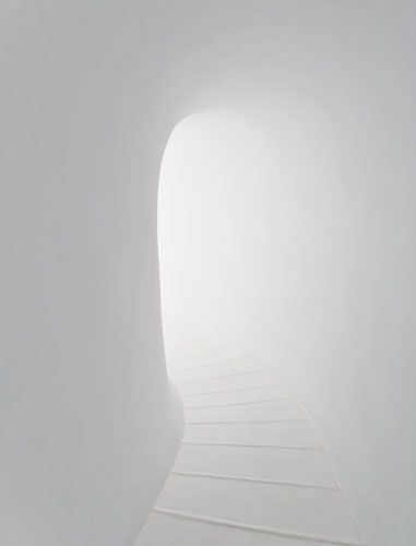 Love the rounded tunnel arch effect and the glow bouncing off the white walls of this stairway. So clean and peaceful like a dream where at the top you enter a ......well you can fill that in yourself and probably have.