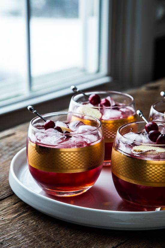 Cranberry Ginger Cocktail - Cranberry Juice, Vodka, Ginger Simple Syrup (Recipe), Ginger Liqueur, Angostura Bitters, Cranberries and Ginger Coins to Garnish.