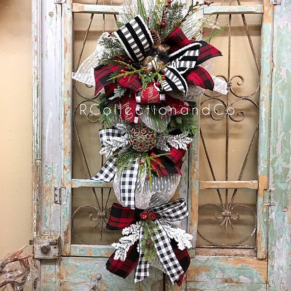 Christmas Swag, Christmas Door Swag, Christmas Wreath, Christmas, Swags Owl Christmas Door Swags are designed with the highest quality in Season designer ribbon and florals market has to offer. ▪️Base-Faux Pine Teardrop swag ▪️Ribbon- ▪️Florals- Measurements- ▪️Length-44 ▪️Width-21