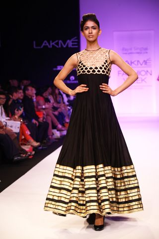Black Cutwork Koti worn with Silk Mul Kalidaar Kurta and Churidaar. Shop The Look at http://www.payalsinghal.com/off-the-runway/zahabia-suit