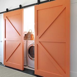 I would LOVE to do this on our laundry closet and this picture from House Beautiful has my wheels turning! Right now our laundry closet has those cheap bifold doors that pinch little fingers. I think this could be recreated with MDF molding on flatfront doors. I would also improvise on the hardware since I know it is incredibly pricey. Didn't someo
