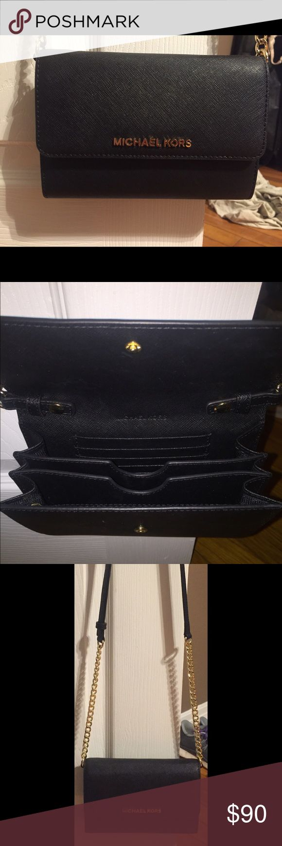 Michael Kors side purse Leather, Adjustable strap, 5 card slots, fits iPhone 6 in the pocket, great condition carried once. Michael Kors Bags Shoulder Bags