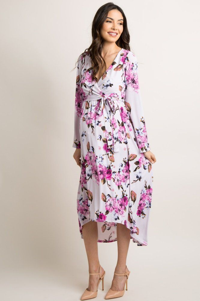 0e9f94ba3952 A maternity wrap dress featuring a beautiful floral print and a hi-low midi  hemline. Also features a v-neckline, long bell sleeves and a cinched  elastic ...