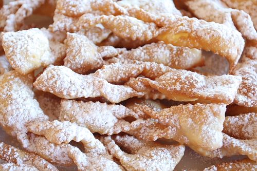 "Chiacchiere - The word ""chiacchere"" translates into ""chatter"", ""chit-chat"", or ""gossip"", but in this context it is a strip of sweet pastry dough fried and coated with powdered sugar. These crispy strips of dough are made throughout Italy and are called by various [Read more...]"