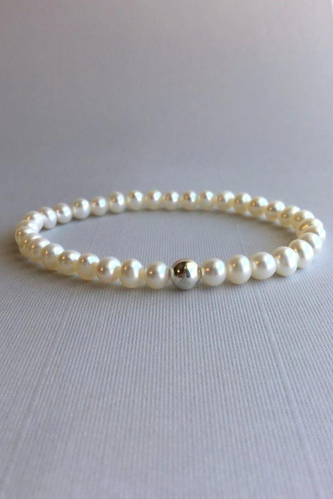 2b2f08658b44ec This elegant freshwater pearl bracelet is a modern interpretation of  classic pearl jewelry. The genuine pearls have a single Sterling silver  bead as a ...