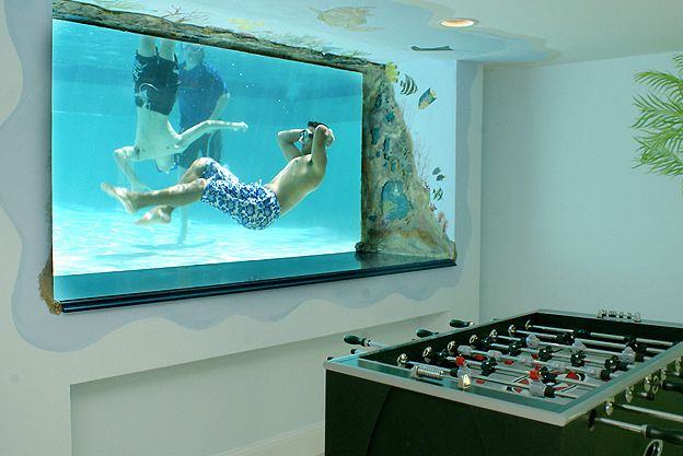 Basement window that looks out into the pool. THIS WOULD BE SO SICK