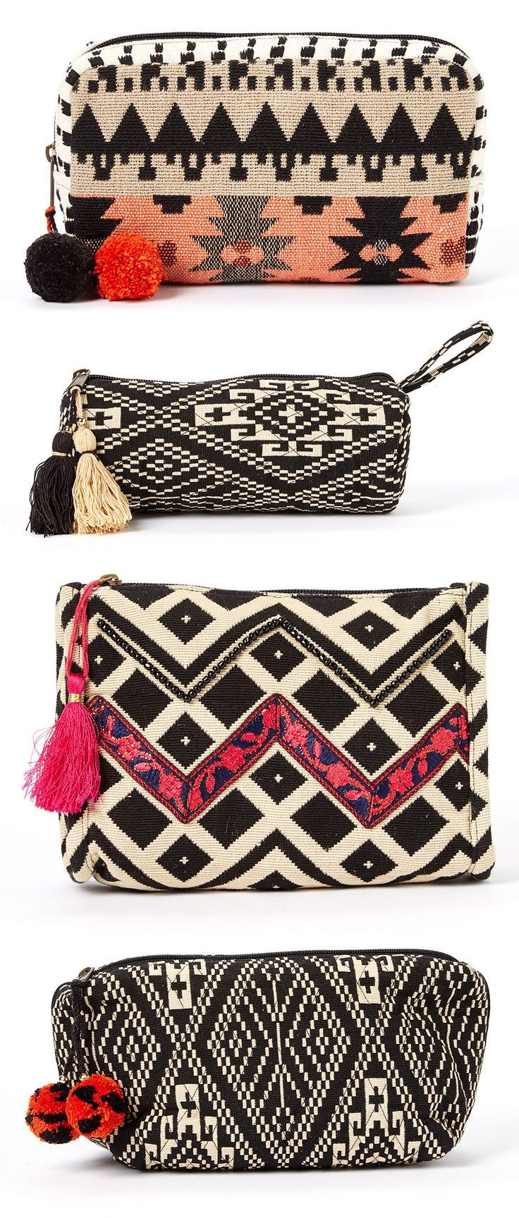 Love these fabrics! Black & orange tribal cosmetic bags with pom poms & tassels.