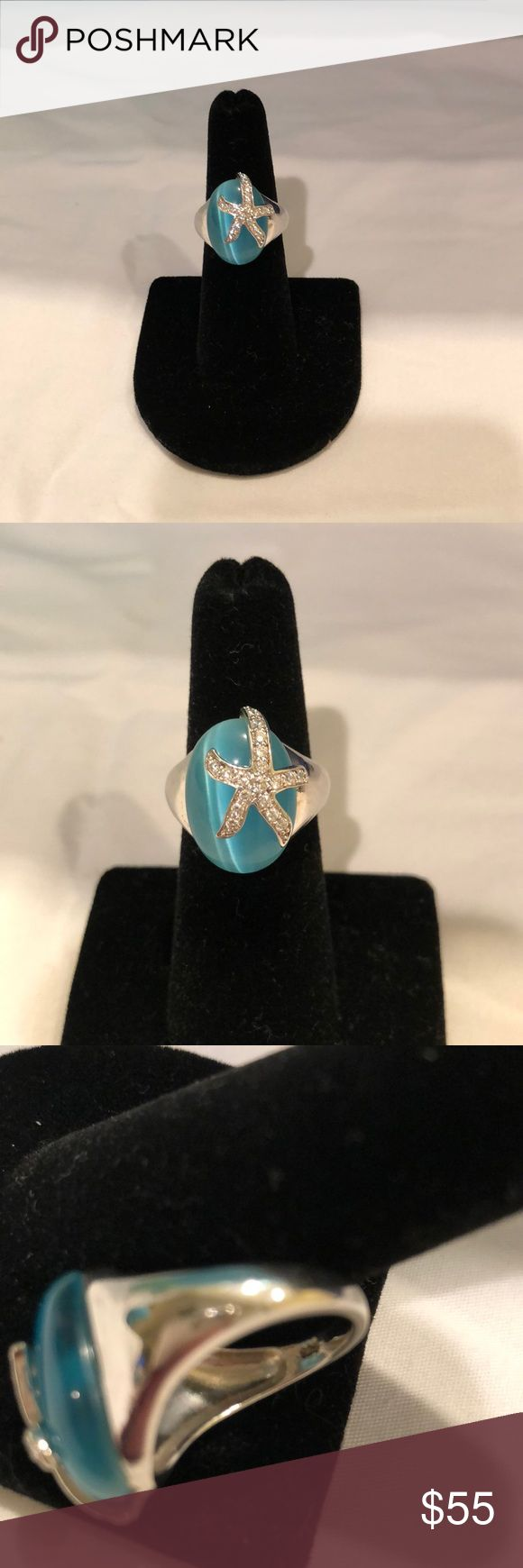 Sterling silver Blue cats eye stone Starfish ring This gorgeous piece came from Burke's Jewelers, our local fine jewelry store.  They sell and design a lot of nautical jewelry.  This piece does show signs of wear, but in excellent condition.  Stamped 925, and the starfish has beautiful cz stones.  Smoke free home! Jewelry Rings