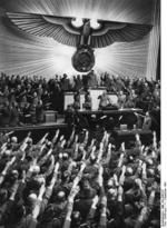 [Photo] Adolf Hitler receiving salutes from the German Reichstag upon declaring war on the United States, Kroll Opera House, Berlin, Germany, 11 Dec 1941