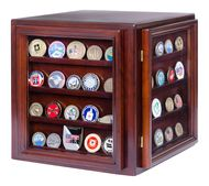 Wooden display case showing military challenge coins on four sides