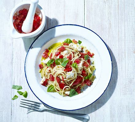 Bashing tomatoes, chilli, sugar and shallots together in a pestle and mortar helps to bring out the flavours for a delicious no-cook pasta sauce. Make it more indulgent with creamy burrata cheese