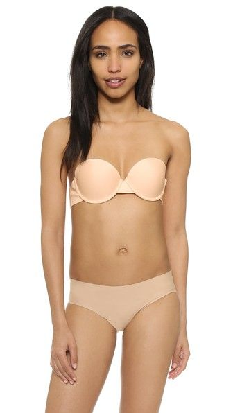This sculpted The Natural strapless bra is designed for a smooth fit beneath any silhouette. An invisible back band secures the bra to the body with adjustable hook-and-eye closures. Molded cups. Optional clear straps included.