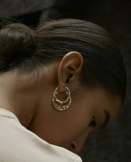 Small or medium gold hoop earrings