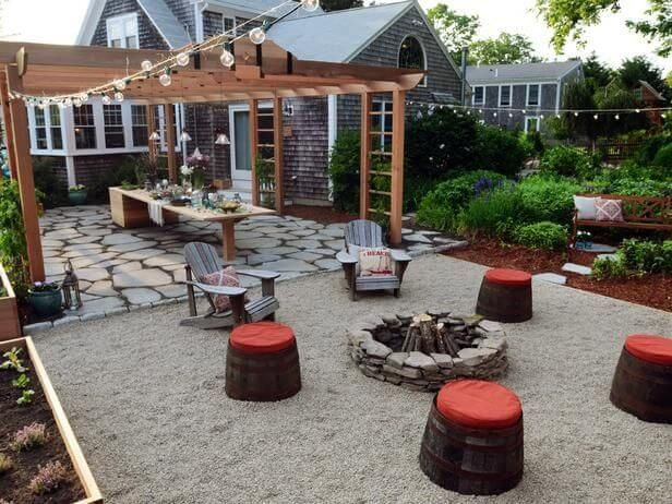 Everything about this is AwEsOmE!! Raised bed gardening, lighting, seating and firepit with a beautiful flower garden!