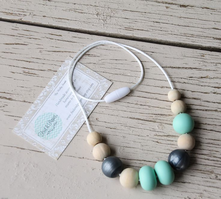 Silicone Wood Teething Necklace ~ Graphite Mint by FredandPepperShop on Etsy https://www.etsy.com/au/listing/474187916/silicone-wood-teething-necklace-graphite