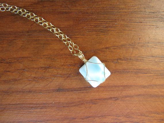 Blue+larimar+cabochon+hand+wrapped+in+gold+fill+wire+on+14Kt+gold+fill+chain.+Elegant+ocea... $87