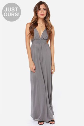 """LuLu*s Exclusive! We could talk for days about the At Great Length Grey Maxi Dress and never run out of praise! A sleeveless bodice is prepared to stun with a deep V front and back, and a panel of shirring below the bust to create a lovely shape. Soft and stretchy jersey knit plummets into a full maxi skirt. Bodice is lined. Model is 5'7"""" and is wearing a size X-small. 95% Rayon, 5% Spandex. Hand Wash Cold. Made with Love in the U.S.A."""