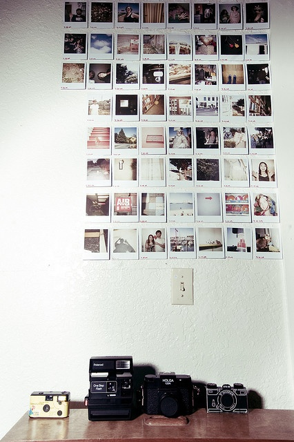 Polaroid Wall. I quite like this. Someday when I'm super rich...