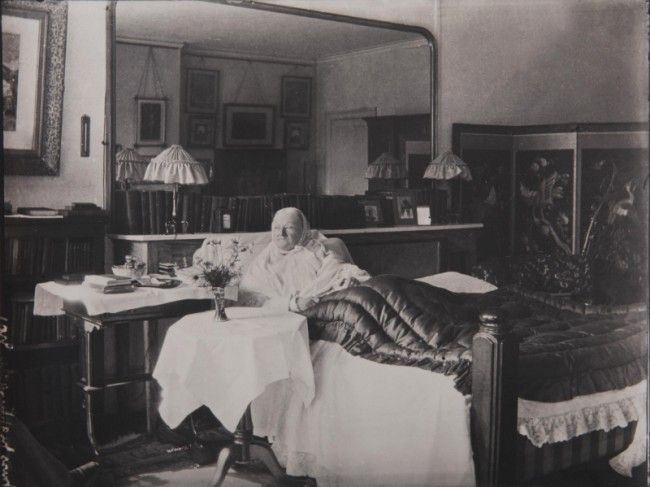 "The photo was taken in 1910. It's the last photograph taken of Florence Nightingale. (It's rare: she was reluctant throughout her life to be photographed.) It shows 90 year old Florence in her bedroom at her home in London. The photo was taken by Lizzie Caswall Smith. On the back of the photo Smith wrote, ""Taken just before she died, house near Park Lane."