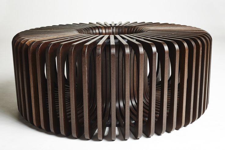 Handmade repetition in smoked oak. Create your own shape. #Display #furniture #smokedoak #design #circle http://www.kjeldtoft.com/