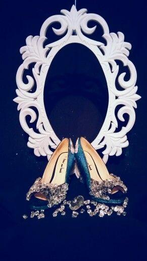 Ornate frame and sparkle heels