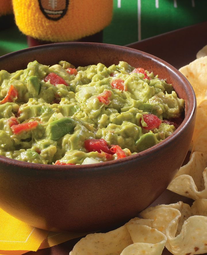RO*TEL Rockin' Guacamole...Easy guacamole recipe 'rocks' with zesty RO*TEL tomatoes, onion and lime juice added to creamy mashed avocados