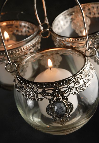 Silver and Glass Three Hanging Candles Holders (set of three assorted) $4.99 set/ 3 sets for $4 set.  I want boho type lanterns/holders.