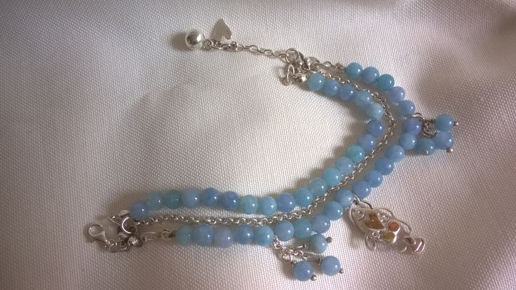 Blue gemstone beads and sterling silver bracelet with a fish charm
