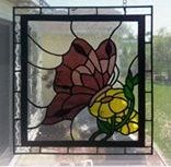 This stained glass butterfly panel was crafted in three shades of puprle...the dark glass is a very deep purple....there is sentimental reasons for my customer's color selections making it very special to her.
