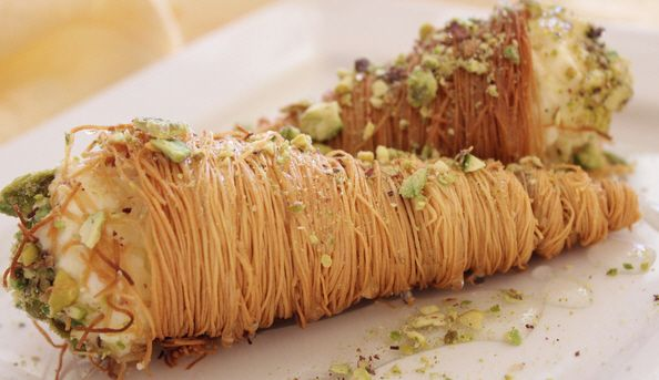 Kadaif is a pie with sweet noodle covered with syrup and pistachios