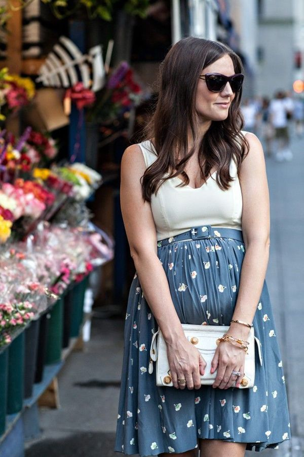 Pull your skirt up over the bump, tuck in a blouse, add a belt to create a waist.