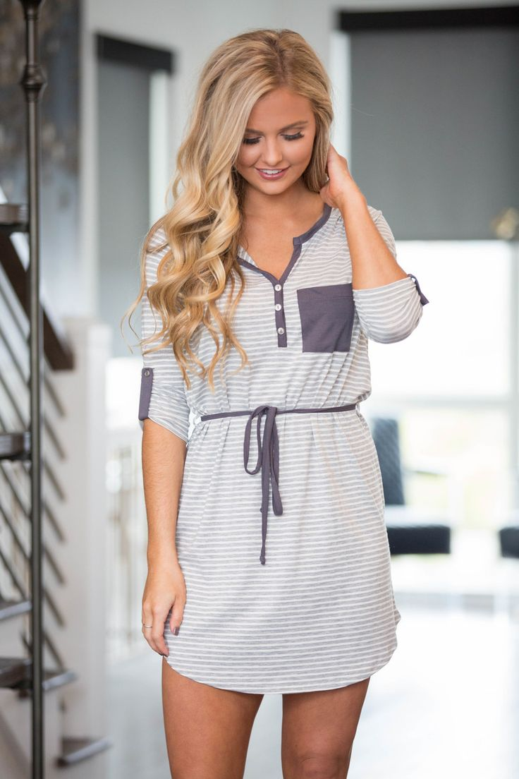 This sweet striped dress couldn't be more perfect for spring adventures! Featuring a beautiful heather grey color paired with white stripes, it's simply the sweetest! The slightly ribbed material is s